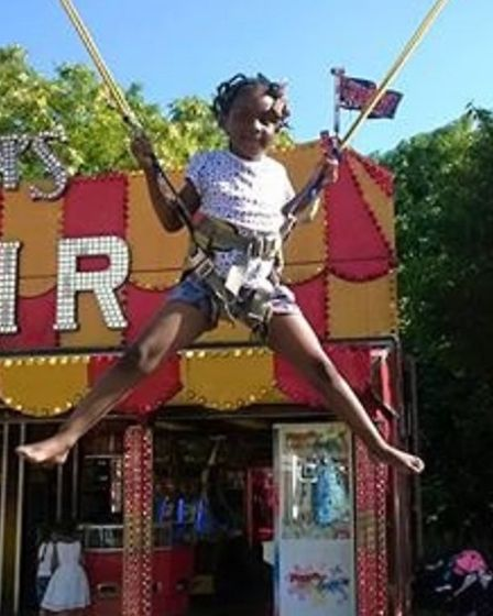 Alexia always loved the swings and enjoyed amusement parks