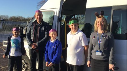f Councillor Robert Everitt, Alison Weir, Acting Headteacher of Howard Primary School and pupils with the school minibus.