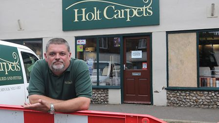 Garry Wood manager of Holt Carpets has had to close the shop after a car crashed into the front wind