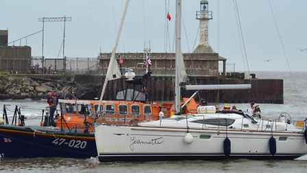 The lifeboat with the yacht Picture: Mick Howes