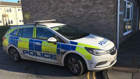A police car at the scene of a stabbing in Hobart Lane, Norwich