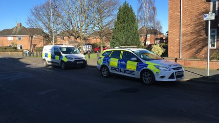 A police car and forensics van on Southwell Road, Norwich