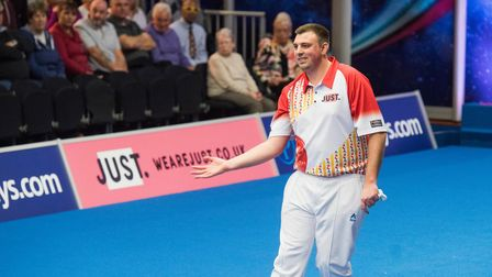 Wayne Willgress wins his match against Greg Harlow during the World Indoor Bowls singles championshi