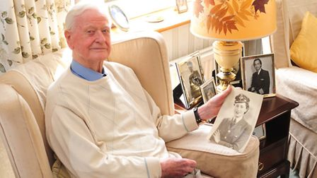 Battle of Britain pilot Tom Neil with photos of his late wife Eileen who also had a distinguished ca