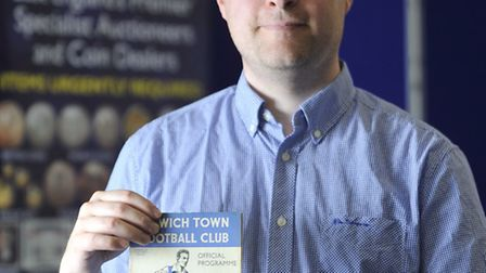 Chris Elmy, of Lockdales Auctioneers, holds an extremely rare 1936 Ipswich Town FA Cup home programm