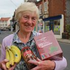 Campaigner Brenda Smith with some of the produce on sale in shops at Sheringham, which has just won