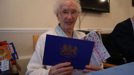 Nelly Manzonas on her 100th birthday at Alexander Court in Thetford with her telegram from the Queen