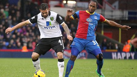 Bradley Johnson of Norwich and Cameron Jerome of Crystal Palace in action during the Barclays Premie