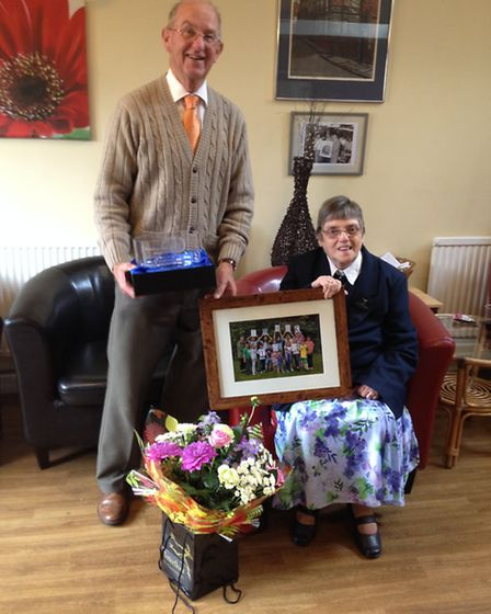 Michael and Sylvia Porter with their thank-you gifts after raising £100,000 for the Norfolk Deaf Chi