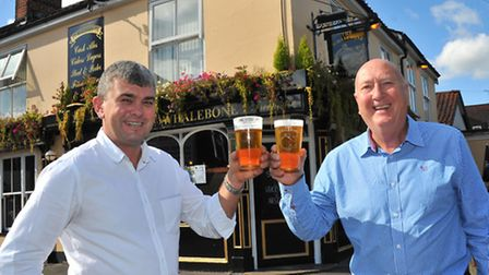 Steve Fiske and owner Mike Lorenz celebrate their 20 year working relationship at the Whalebone pub