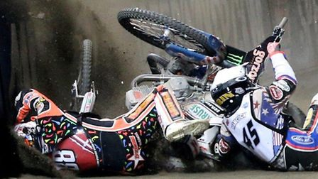 Niels-Kristian Iversen, red, and Greg Hancock slam into the deck during Saturday's meeting. Picture: