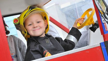 Firefighter of the future Ollie Row(4) at family fun day at the Diamond Jubilee Fire and Resuce Stat