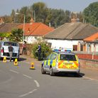 Olive Road, Costessey, as police search a bungalow during an investigation into allegations of a hi