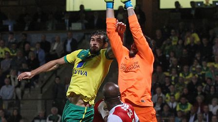 This challenge by Norwich City's Bradley Johnson on Charlton goalkeeper Stephen Henderson ruled out