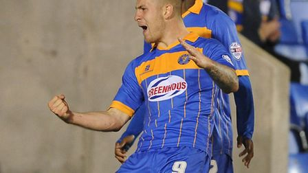 Shrewsbury Town's James Collins celebrates the goal that dumped Norwich City out of the Capital One
