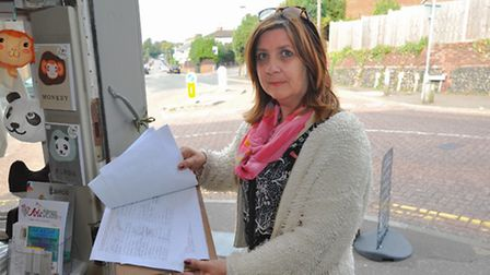 Kay Spalding with the petition at her shop, Arts Desire, at the junction of Park Lane and the Avenue