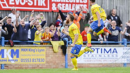 FA Cup action from King's Lynn Town v Hednesford at The Walks - Lynn's George Thomson celebrates sco