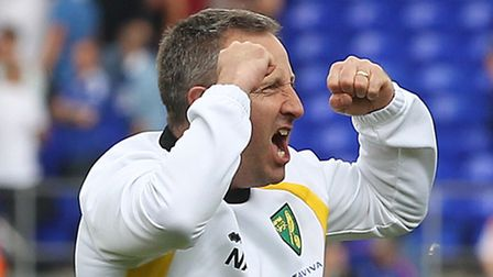 Norwich City manager Neil Adams celebrates victory over Ipswich Town at Portman Road.