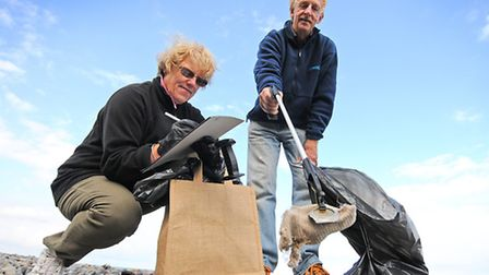 Sheringham beach clean. Anne and Bob Smith from Sheringham.Picture: ANTONY KELLY