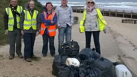 Volunteers on the Bacton beach clean event. (From left) Phil Wills, Moyra Wills, Shelly Duddy, Chris