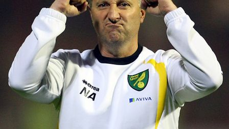 Norwich manager Neil Adams salutes the travelling support after a 3-0 Championship win at Brentford.