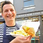 Christian Motta with fish and chips from his Grosvenor Fish Bar, which has been announced as the top