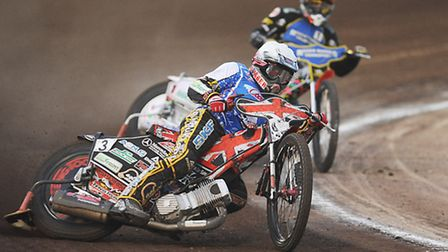 Chris Harris leads Niels-Kristian Iversen while guesting for Poole earlier this season. Picture: Ian