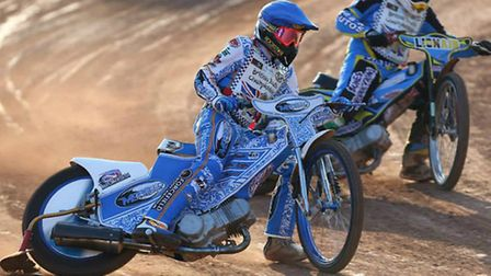 Talented King's Lynn teenager Lewis Whitmore, blue helmet, in speedway action.