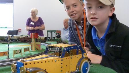 Nathan and Louis Howard look at an exhibit at the Meccano and Hornby exhibition