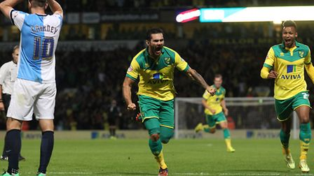 Bradley Johnson wheels away to celebrate scoring Norwich City's second goal in their eventual 3-1 wi