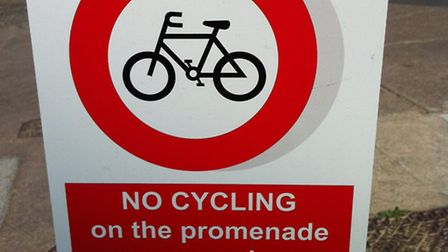 One of the signs on Cromer promenade about the cycle and motor vehicle ban.