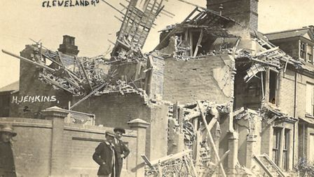 Youngsters pose in front of wrecked homes in Cleveland Road, Lowestoft in one of the postcards of th
