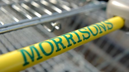 File photo dated 18/03/2014 of signage for Morrisons supermarket on a trolley handle, as profits at