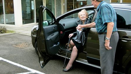 Volunteer driver Peter Corran giving a helping hand to Thelma Webb at Holt Medical Practice. Pictur