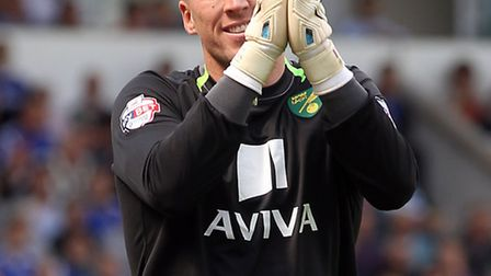 John Ruddy of Norwich enjoys some banter with the home fans during the Sky Bet Championship match at