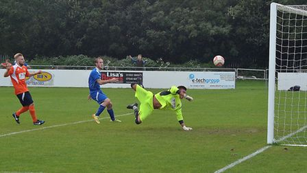 GOAL: Kirkley and Pakefield FC's Kyle Baker (blue) celebrates a goal during their FA Vase win over D