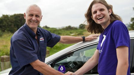 Paul Walker of ABC Taxis (left) with Steffan Aquarone, the chief executive of Droplet. Picture submi