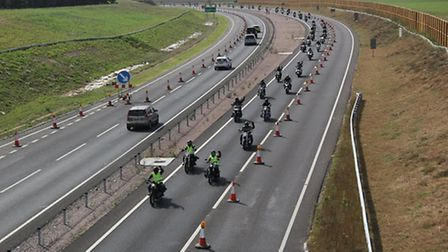 Motorcyclists protest the use of steel wire barriers on the A11.