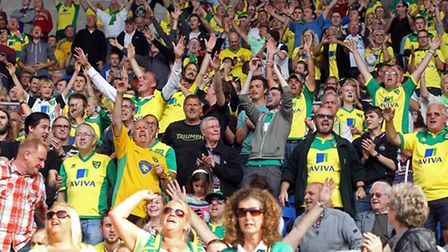 The traveling Norwich fans celebrate victory at the end of the Sky Bet Championship match at the Car