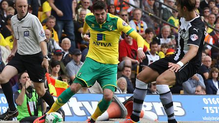 Kyle Lafferty of Norwich and Gabriele Angella of Watford in action during the Sky Bet Championship m