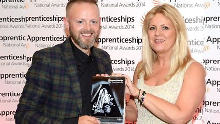 Paul Davies and Jane Howling with the Small Employer of the year trophy