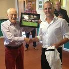 John Humby being presented with a commemorative photo by Chris Brown at the surprise pre-match lunch
