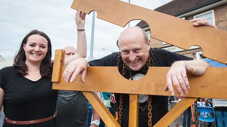 Trafford Arms landlord Chris Higgins is led to the stocks and doused by Emily Nudd and Norwich City