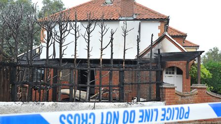 Police at the scene of the third suspected arson attack this week in North Norwich, at the junction
