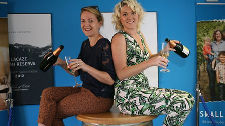Laura Hodges (blue top) celebrates joining Naked Wines with her friend Tina Dalzell, whio introduced