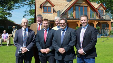 Celebrating the opening of the new sports pavilion at Gresham's School earlier this summer. From lef