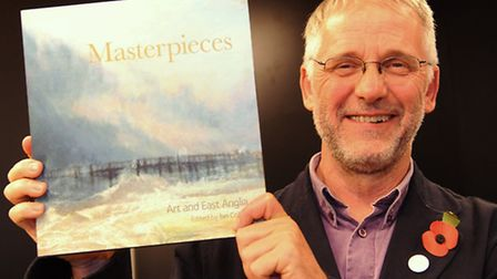 Ian Collins, the overall winner of the 2013 EDP/ Jarrold East Anglian Book Awards, with the book he