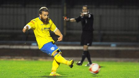Lynn's George Thomson strokes home his first penalty of the night. Picture: Ian Burt