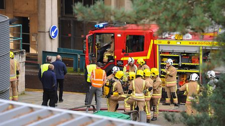 Firefighters at the scene of the fire in a chemistry laboratory at the UEA. Picture: DENISE BRADLEY