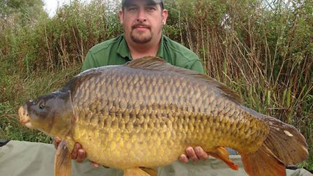 Ben Pointer holds his 27lbs 9oz catch from Billingford Lakes